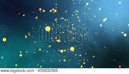 Image of warm glowing yellow spots floating on blue background. light, colour and movement concept digitally generated image.
