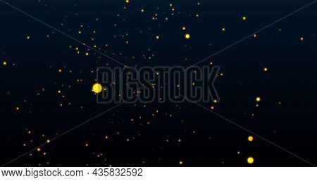 Image of warm glowing yellow spots on black background. light, colour and movement concept digitally generated image.