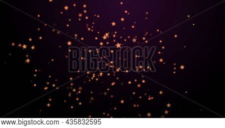 Image of warm glowing orange spots floating on black background. light, colour and movement concept digitally generated image.