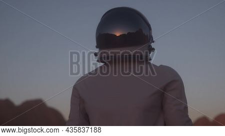 Portrait Shot Of The Astronaut Wearing In Helmet On The Distant Planet. Space Travel, Exploration An