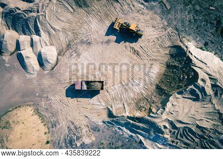 Opencast Sand Quarry, Industrial Extraction Of Sand For Construction Industry. Loader Load Sand Into
