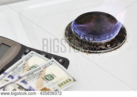 Burning Gas Stove Burner, Calculator And Us Dollar Banknotes. Pay For Natural Gas, Bill, Tariff. Pil