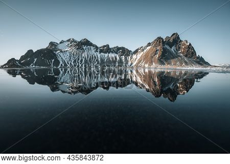Aerial Drone View Of Splendid Sunny Day And Gorgeous Reflection Of Vestrahorn Mountaine On Stokksnes