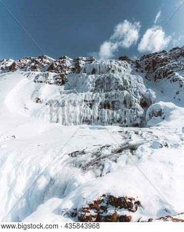 Aerial Drone View Of Dynjandi Foss Cascade Waterfall With Ice Canyon In The Foreground. Blue Sky. We