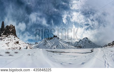 Beautiful Panoramawinter Scenery In The Icelandic Highlands With Snow Covered Mountains And Blue Sky