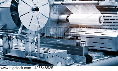 The Operation Of Automatic Plastic Bag Production Machine With Lighting Effect. Close-up Of The Roll