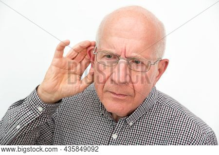Senior Suffering From Deafness. Man Asks To Repeat The Question