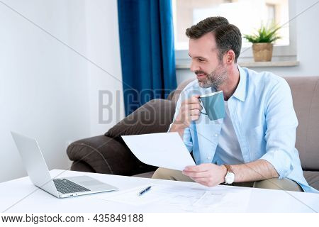 Man Sitting At The Table. Home Budget, Finances Concept