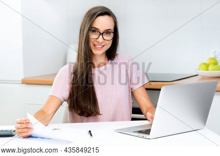 Woman Working With Calculator. Bookkeeping, Home Finances Concept