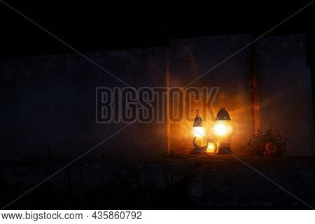 Night Cemetery Background Tombstone With Memorial Lamps Flame Warm Light, Soft Focus Concept With Em