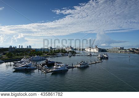 Island Gardens Deep Harbour Marina Under Summer Cloudscape With City Of Miami Skyline And Port Miami