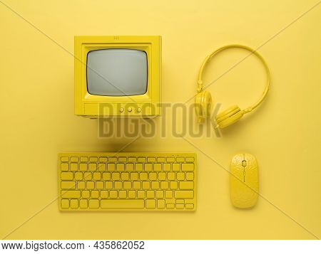 Personal Computer With Accessories In Yellow Style On A Yellow Background. Vintage Equipment. Flat L
