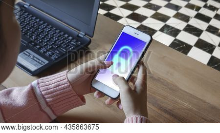 Young Woman Using Smartphone In Home Office Room. Login To Mobile App With Lock Sign Security System