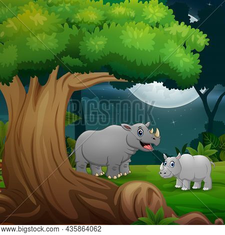 Night Forest With A Mother Rhino And Her Cub Under The Tree