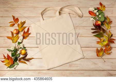 Rustic Tote Bag Mockup With Fall Leaves And Ghostberry