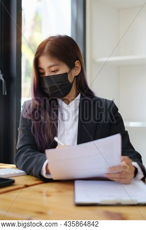 Business Woman Or Broker Wear Mask And Checking Contract Agreement Paper With Customer To Sign Contr
