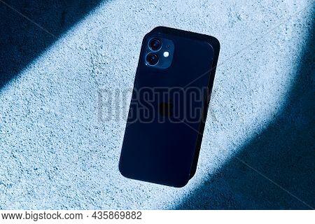 Kaliningrad, Russia - April 15, 2021: Black Apple Iphone 12 On A Gray Background. Latest Model Phone