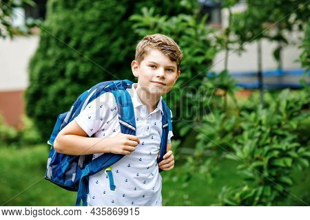 Happy Little Kid Boy With Satchel, Walking. Schoolkid On The Way To Middle Or High School. Excited C