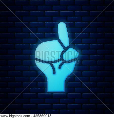 Glowing Neon Hands In Praying Position Icon Isolated On Brick Wall Background. Praying Hand Islam Mu