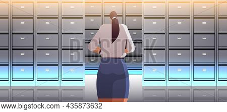 Businesswoman Standing Back To Camera Rear View Of Elegant Business Woman In File Cabinet