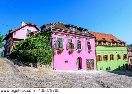 Old Colorful Painted Houses In The Historical Center Of The Sighisoara Citadel, In Transylvania (tra