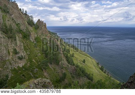 Bay Of Lake Baikal, Russia - August , 2021: View Of Lake Baikal From The Slope Of The Rock Skriper.