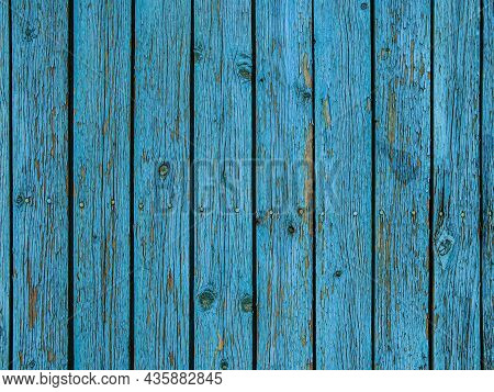 Background Of Blue Wooden Fence Made Of Planks. The Texture Of An Old Rustic Wooden Fence Made Of Fl