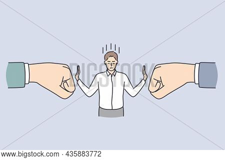 Business Confidence And Strength Concept. Young Calm Businessman Standing And Deflecting Blows From