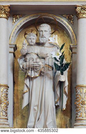 BJELOVAR, CROATIA - SEPTEMBER 06, 2013: Saint Joseph, altar in the Cathedral of Saint Teresa of Avila in Bjelovar, Croatia