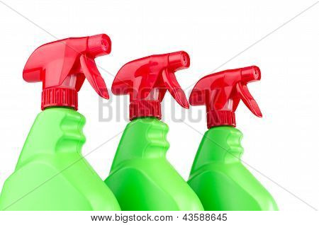 Three plastic spray bottle containers isolated on white background