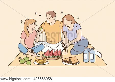 Having Picnic And Leisure Time With Family Concept. Smiling Happy Family Father Mother Daughter Sitt