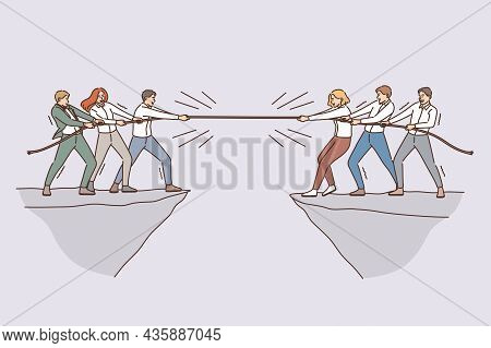 Business Team And Competition Concept. Groups Of Business People Teams Coworkers Competing With Rope