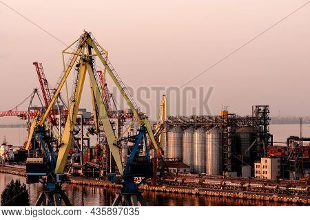 Trade Port At Sunset. Delivery Of Cargo To The Port. International Water Transport. International Sh