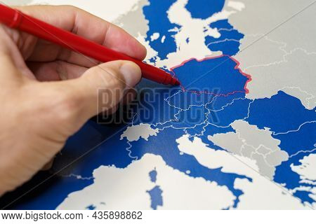 Hand Drawing A Red Line Between Poland And The Rest Of Eu, Polexit Concept.