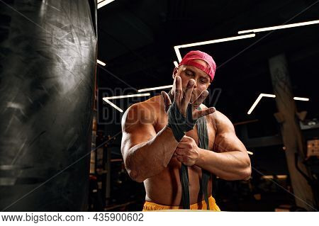 Strong Athletic Fitness Men Pumping Up Arm Muscles Workout Barbell Curl. Fitness Concept Background