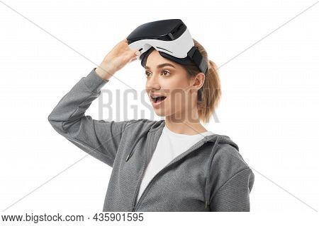 Astonished Young Female In Vr Goggles For Virtual Reality Looking Away On White Isolated Background