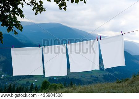 Bedclothes Hanging On Washing Line In Mountains