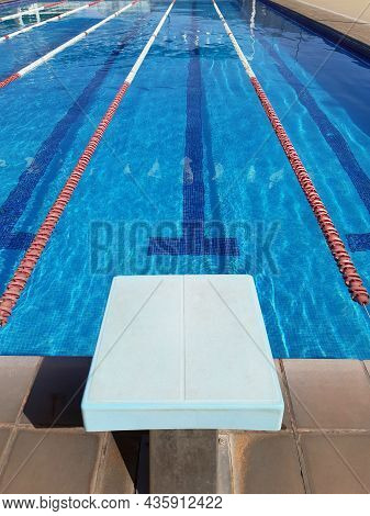 Perspective View Of Competition Pool Lanes With Floating Lanes And Start Block. Water Sport, Swimmin