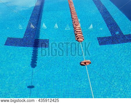 Swimming Lane Detail Background In Competition Pool With Floating Lane Lines. Water Sport, Swimming