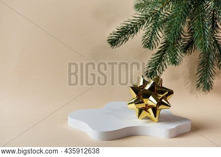 Christmas Mock Up With White Podium On Beige Background With Christmas Decor. Place For Christmas Pr