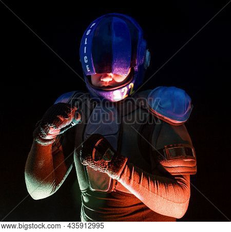 Male Robot Cop Waves And Punches His Fits In Dark. Halfman Is Ready For Fight. Bionic Cyborg Looks A