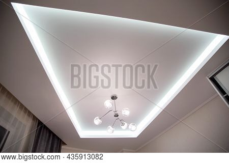 A Beautiful Stretch Ceiling With Diode Lighting And An Unusual Chandelier With Balls. Designer Moder
