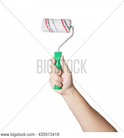 Construction Roller For Painting In A Man's Hand On A White Background, Isolate. Close-up, Professio
