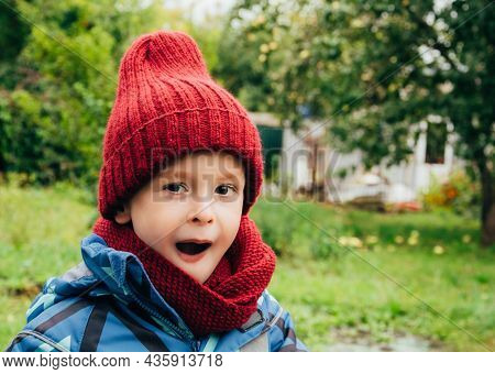 Child Expresses Emotions Outdoors, Amaze, Surprise And Wow. Copy Space