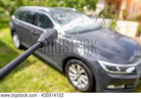 Car Wash With Modern Car Shampoo Using A High Pressure Washer In Summer. Background, Cleaning Cars F