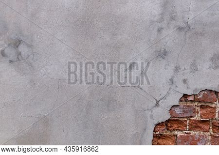 Background - Gray Plastered Brick Wall With Partially Peeled Off Plaster