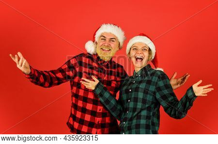 Couple In Love New Year Eve. Christmas Time. Wear Santa Hat. Man And Woman Christmas Holiday Celebra