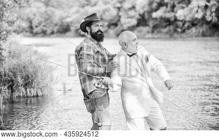 Fishing Skills. Men Friends Relaxing Nature Background. Personal Instructor. Bearded Man And Elegant