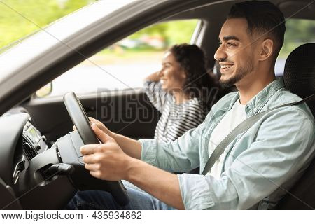 Smiling Young Middle-eastern Man And Woman Sitting In Luxury Car