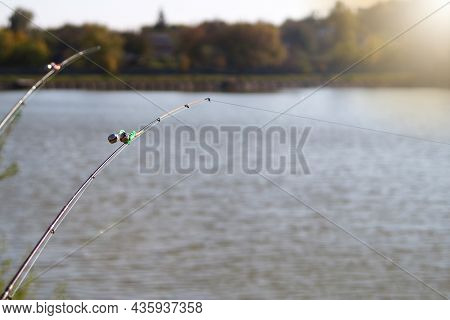Peck-bell Signal, On The Tip Of The Fishing Rod. Bell Attachment For Night And Day Fishing On A Lake
